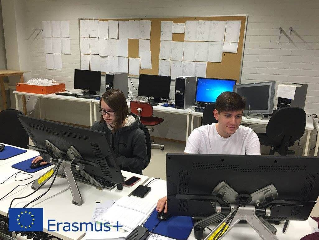 Erasmus students working with computers