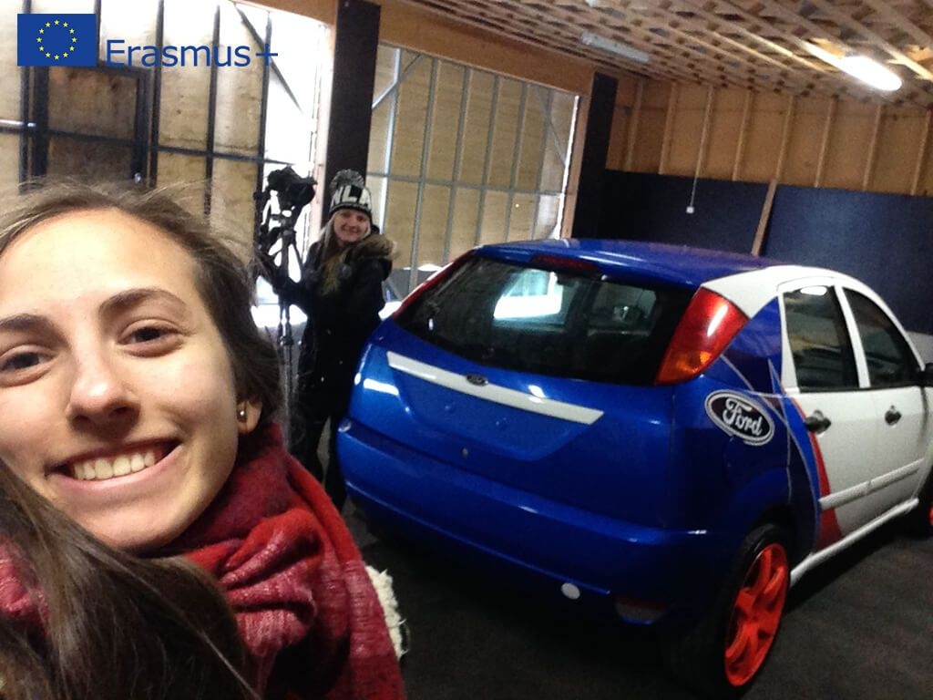 Students photographing with a car