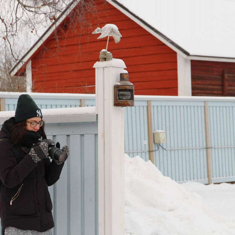 Student taking photos in Raahe during winter